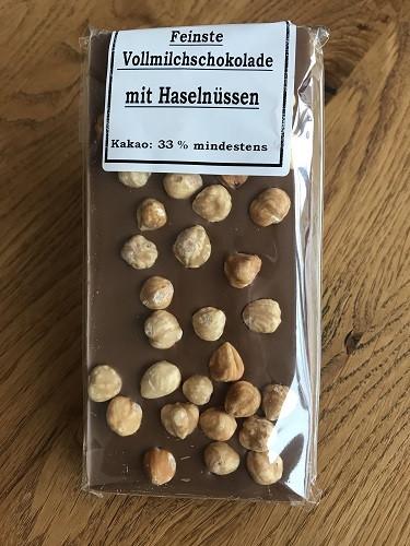 Vollmilch-Schokolade mit Nüssen 100g